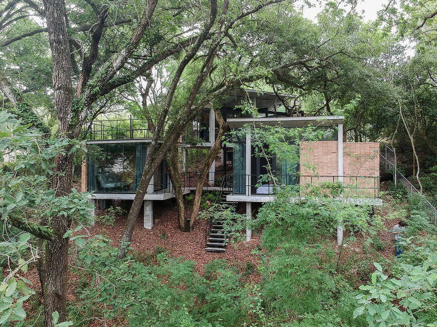 Modern Forest House Consisting of Small Pavilions Connected by External Walkways