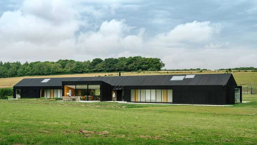 A Contemporary Hampshire Barn Set within a Landscape of Fields and Woods