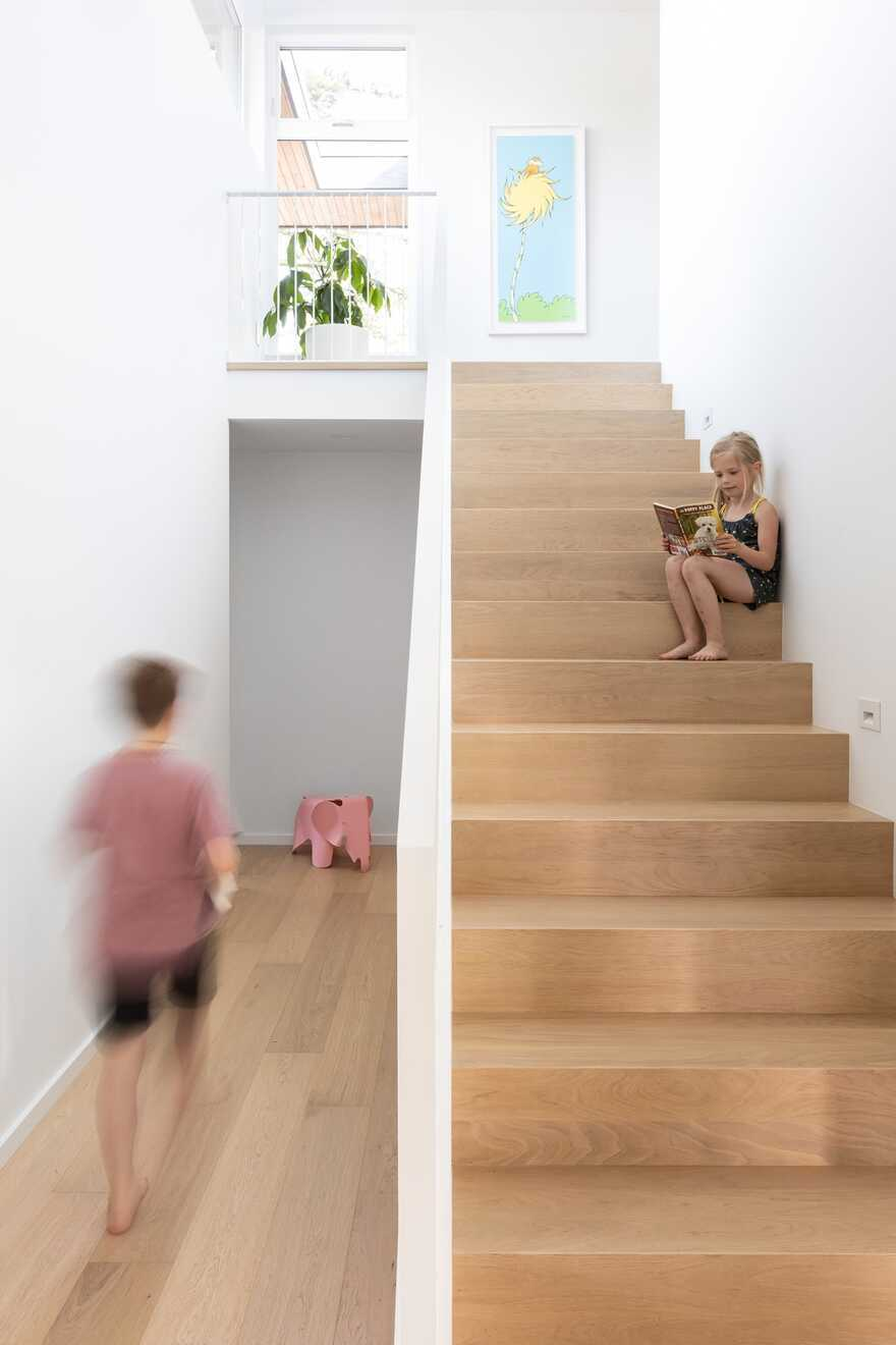 staircase, Black Box House inspired by the surrounding coastal rainforest and mid-century design