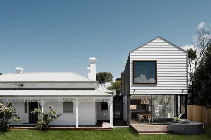 an old house extended with two contemporary sculptural pavilions
