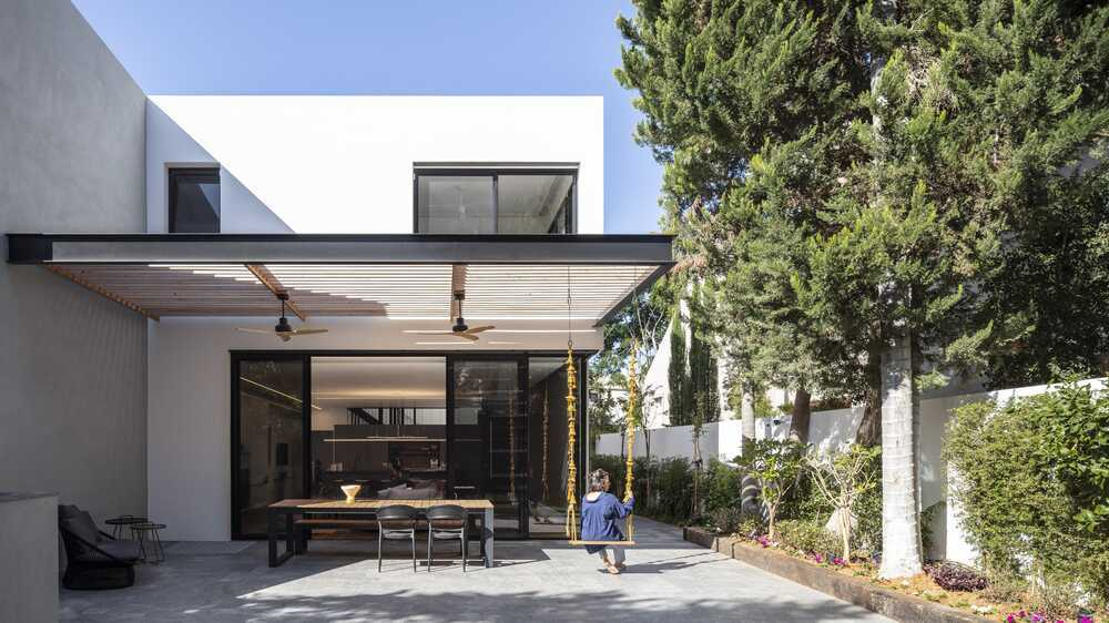 An Architectural Mass of Two Asymmetrical Blocks in Size, Color and Shape