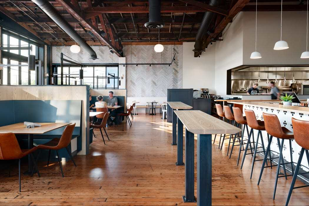 Graham Baba Architects Designs Sawyer, a Contemporary Seattle Restaurant Located in a Historic Canal-Front Sawmill