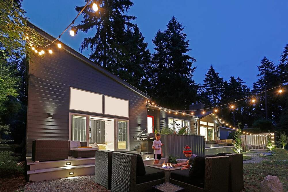After: the remodeled house with the family room addition on the left at dusk