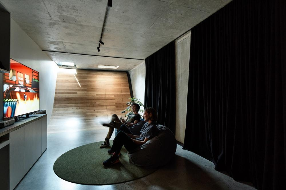 The basement is a dedicated space for the boys' gaming activities and other passion projects.