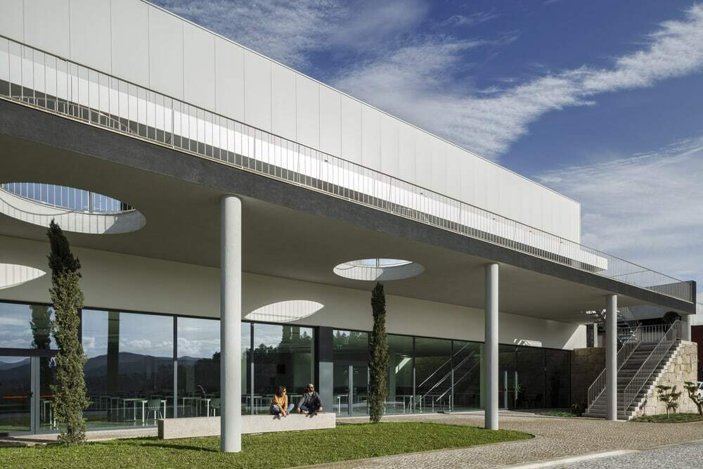 The Balcony That Extends the Landscape in an Industrial Building